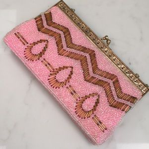 Pink and gold evening purse with strap